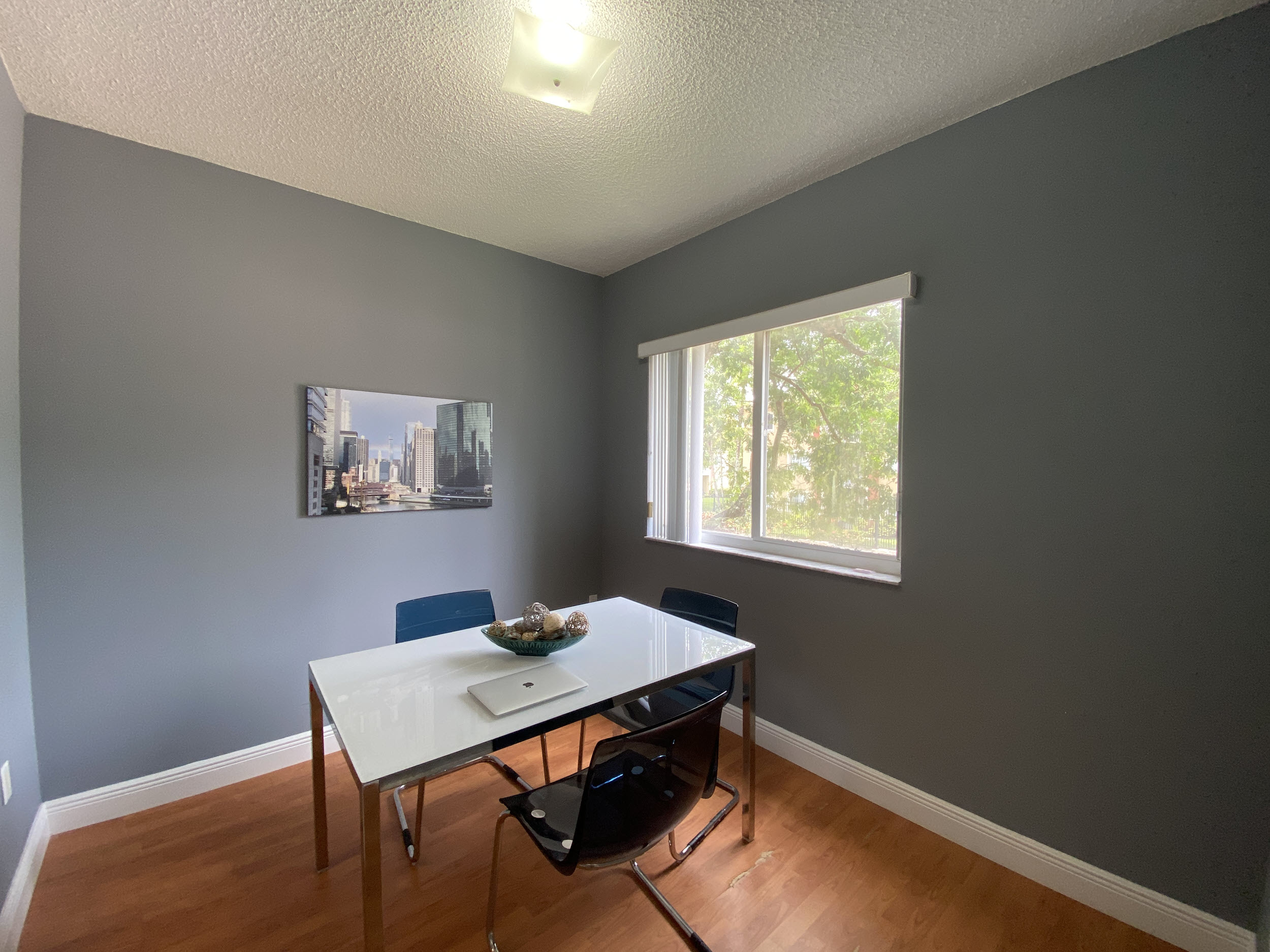 dining room area with view of pool in university parc residence condos unit 220