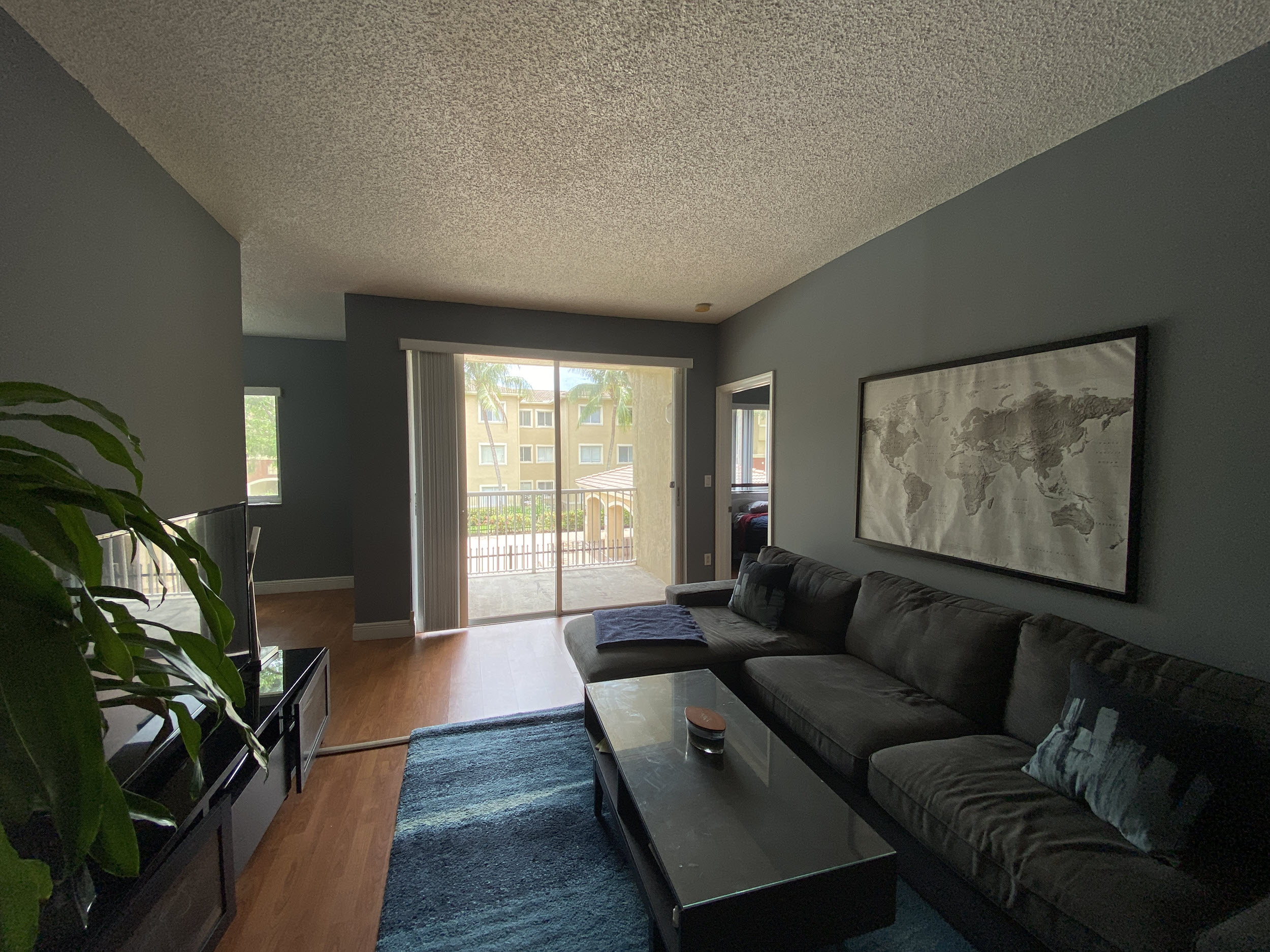 living room view overlooking pool in university parc residence condo unit 220