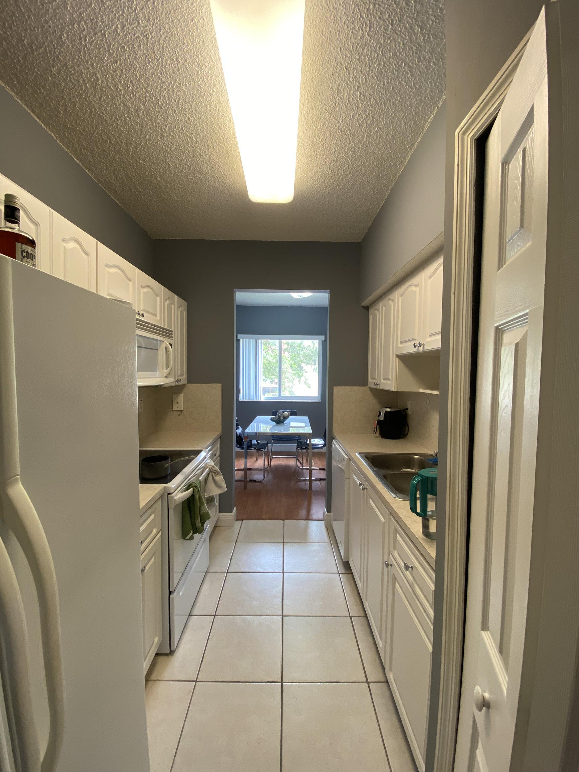 second view of kitchen university parc residence condo unit 220 davie florida